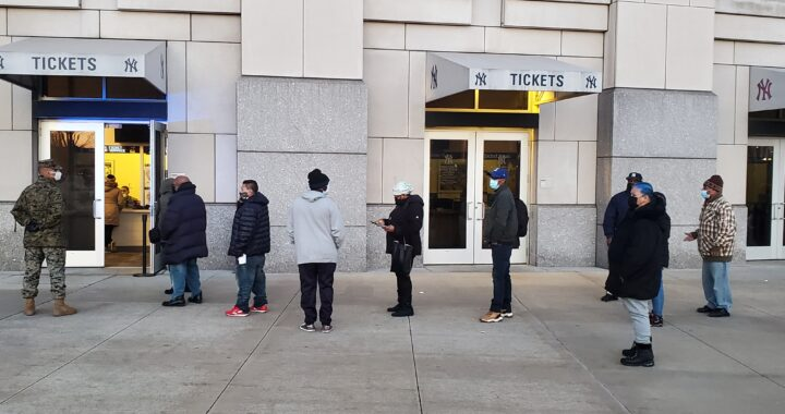 Bronxites line up outside Yankee Stadium to strike out COVID